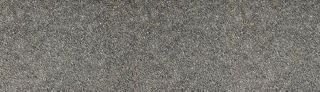 Natural stone wall wide texture. Pebble dash rough surface panorama. Pebbledash panoramic background Фото со стока