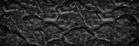 Black panoramic rippled surface background. Old cement wall wide texture. Dark gloomy backdrop Фото со стока
