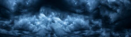 Dark cloudy sky before thunderstorm panoramic background. Storm heaven panorama. Wide gloomy backdrop