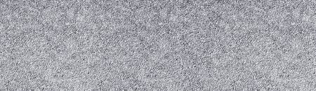 Light gray stone wall wide texture. White washed pebble dash panoramic background Stock Photo