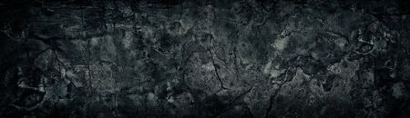 Wide weathered cracked black concrete wall. Black broken cement surface texture. Dark gloomy grunge background Фото со стока - 132024861