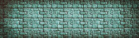 Teal stone wall wide texture. Patterned block pattern retro background. Long vintage backdrop Фото со стока - 132024943