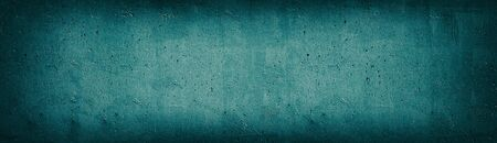 Teal old concrete wall wide texture. Rough cement surface panoramic retro background. Long dark turquoise vintage backdrop Фото со стока - 132025304