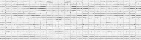 Wide old white brick wall texture. Whitewashed panoramic brickwork background Фото со стока