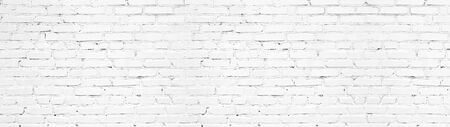 Whitewashed brick wall panoramic texture. White painted old brickwork panorama. Widescreen light background