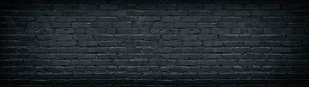 Widescreen black brick wall texture. Aged rough masonry background. Dark brickwork wide back wallpapers Фото со стока