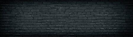 Widescreen black brick wall texture. Aged rough masonry background. Dark brickwork wide back wallpapers Фото со стока - 132024955