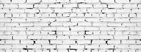 Wide white brick wall texture. Old rough whitewashed brickwork. Grunge background
