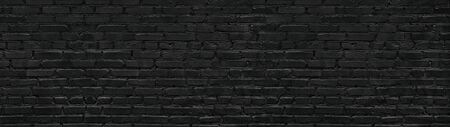 Black brick wall texture. Gloomy grunge panoramic dark background