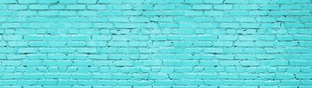 Pastel blue brick wall wide panoramic texture. Bright turquoise painted old brickwork widescreen background