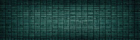 Dark teal brick wall wide texture. Color cement block masonry horizontal panorama. Retro grunge background