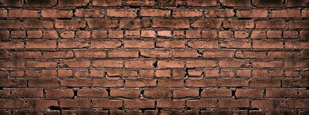 Wide red brick wall texture. Old rough brickwork. Retro grungy background Stock fotó