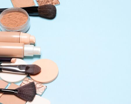 Basic makeup products: primer, concealer, foundation, cosmetic face powder. Make-up background, empty space for text