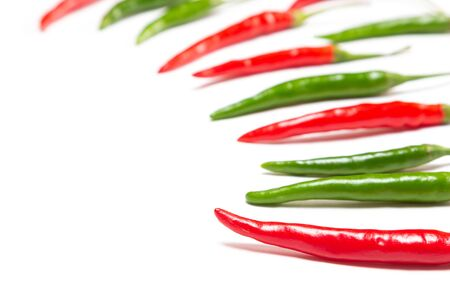 Red and green chili peppers on white background with copy space Фото со стока - 132025316