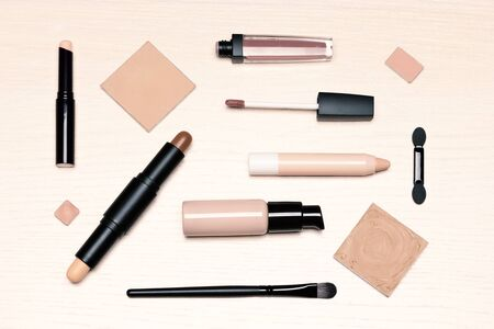 Day makeup set flat lay. Beauty products for natural make-up on light wooden table, top view Imagens - 132025125