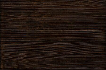 Natural wood texture. Dark brown wooden surface background