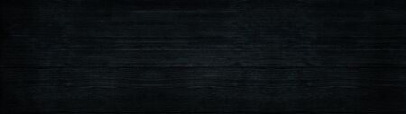 Black wood wide panoramic texture. Wooden backdrop horizontal panorama. Dark timbers surface background Фото со стока