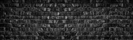 Wide black brick wall texture. Old rough dark grey brickwork masonry widescreen backdrop. Gloomy grunge panoramic background Фото со стока - 132024604