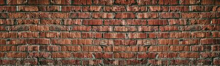 Wide red brick wall texture. Old rough orange brickwork widescreen abstract backdrop. Grunge panoramic large background Фото со стока