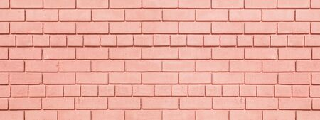 Coral painted brickwork wide background. Brick block widescreen texture. Peach color wall panorama Фото со стока