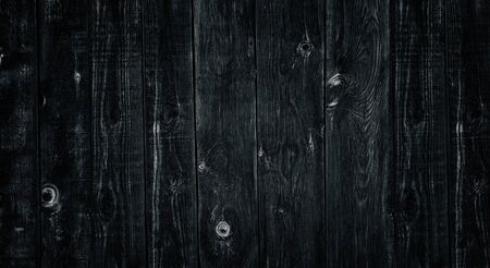 Old rough uneven wooden board dark widescreen texture. Black knotty weathered wood rural background Stock fotó