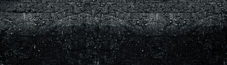 Dark grey wide rough concrete wall texture. Black weathered cement surface widescreen background. Gloomy grunge long panoramic backdrop Фото со стока - 132768386