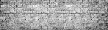 Breite graue Mauer Textur. Grobes hellgraues Mauerwerk. Altes gebrochenes Blockpanorama. Retro-Grunge-Breitbild-Hintergrund Standard-Bild