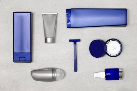 Cosmetics for men flatlay. Male grooming cosmetic products on concrete background. Top view, flat lay