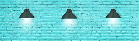Hanging pendant lamps against turquoise painted brick wall. Modern industrial interior background Imagens