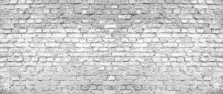 White washed old shabby brick wall wide texture. Large light gray rustic brickwork. Whitewashed widescreen vintage background