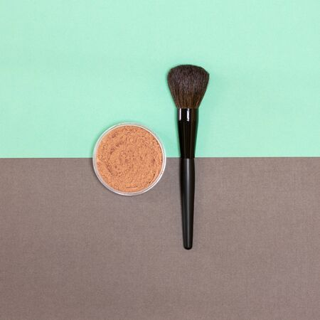 Loose face powder with make-up brush. Top view, flat lay