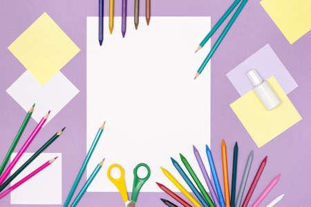 Blank white paper, colored pencils, scissors, correction liquid on the desk. Children's creativity, back to school concept background