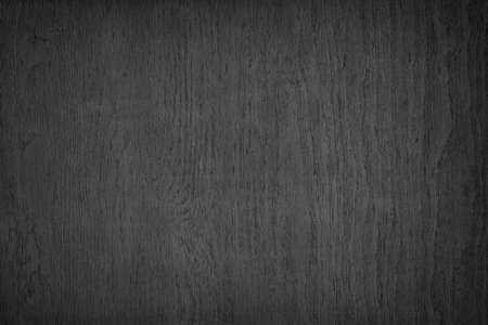 Black plywood rough surface texture. Dark wood backdrop. Abstract wooden background