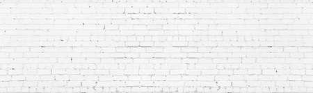 White painted wide brickwork. Whitewashed old shabby exterior brick wall texture. Large long light background