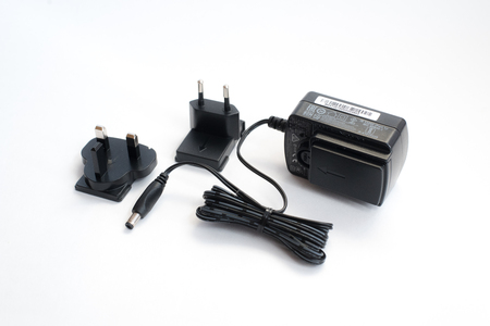 electrics: Laptop or mobile charger power adapter isolated on white background Stock Photo