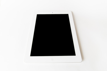 White tablet computer isolated on over white background Stock Photo