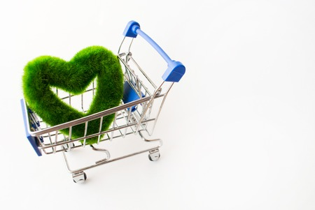 a green heart in a shopping cart on a white background Archivio Fotografico - 90708313