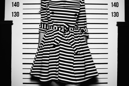 young woman in dress with line standing like for police photo Stock Photo