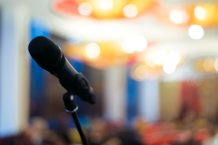 microphone against and music notes blur colorful light background Stock Photo