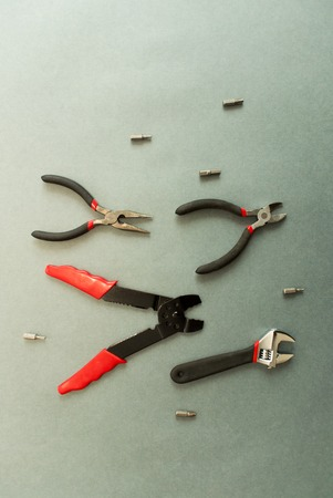 Set of tools on grey background. Looks like a fishes. Stock Photo