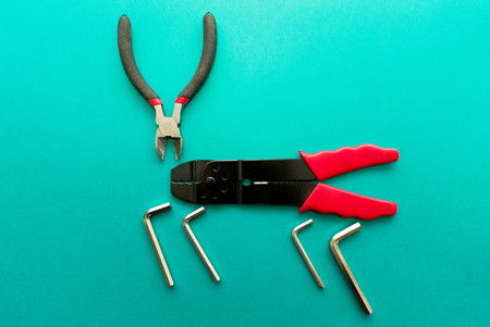 Set of tools on green background. It looks like a deer. Working handmade instruments.