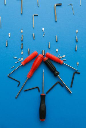 Conceptual set of tools on blue background. It looks like raining. Working handmade instruments. Stock Photo