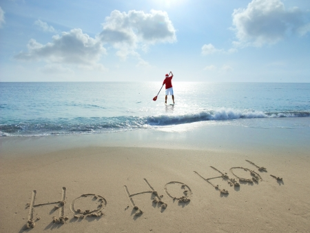 Ho ho ho  written in sand at the beach  Christmas concept