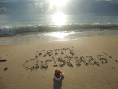 Merry Christmas  written in sand at the beach  Holiday concept