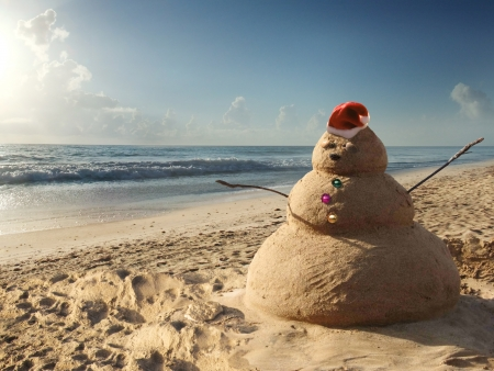 christmas morning: Christmas Sandman at the beach  Holiday concept