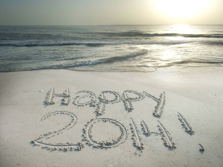 Happy 2014 written in sand at the beach New Year concept