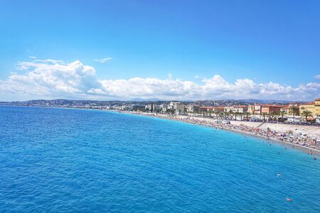 Panoramic view of Nice coastline and beach with blue sky and cloud in background.Beautiful Mediterranean landscape of french riviera near Nice and Monaco.Summer,Holiday concept.