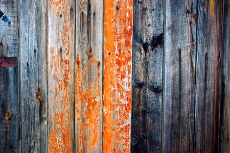 Dirty, stained by a paint the hammered together fence  photo