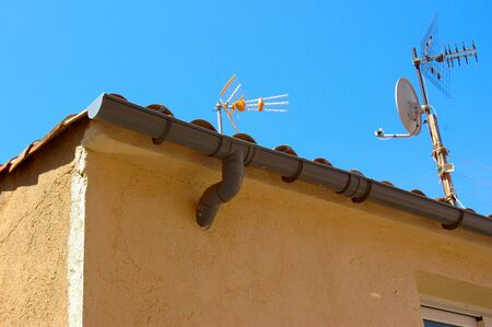 Aerials on a roof of a house photo