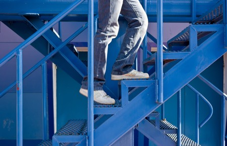 a man running  p the stairs on the background of the building